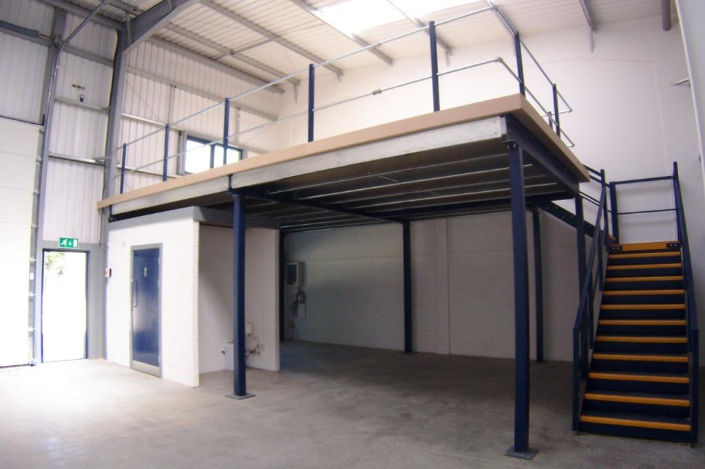Building a mezzanine can utilize wasted space for storage or offices.